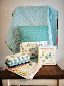 Puddles and Boots Fabric Book Cushion Panel by Diane Rooney